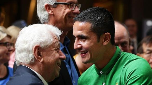 Frank Lowy congratulates a beaming Tim Cahill.