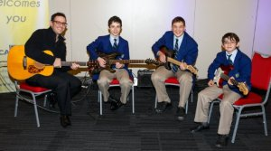 Mr Kaye with three young musicians from Masada provided the musical entertainment (photo Jason Silverstone).