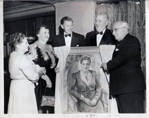 Ida Mayer Cummings is presented with a portrait by her brother Louis B. Mayer and others to celebrate her many years in service to the LA Jewish Home for the Aged.